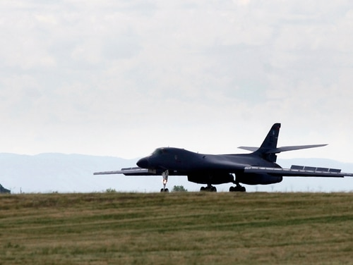 FILE - In this July 15, 2013 file photo, a B-1 bomber touches down at Ellsworth Air Force Base, S.D. The military is set for another large-scale exercise in the Powder River Training Complex that covers nearly 35,000 square miles of airspace in the Dakotas, Montana and Wyoming _ the largest over the continental U.S. Officials at Ellsworth say multiple types of aircraft will take to the skies Tuesday, June 7, 2016 through Thursday, June 9. (Kristina Barker/Rapid City Journal via AP, File) TV OUT; MANDATORY CREDIT