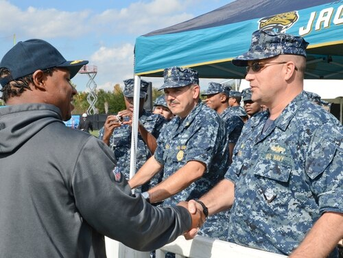 Rear Adm. Erik M. Ross was relieved Friday as the commander of Expeditionary Strike Group 2. Ross is shown here as a captain in 2012, meeting Jacksonville Jaguars running back Maurice Jones-Drew during the city's