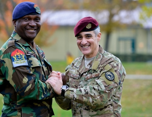 U.S. Air Force Chief Master Sgt. Ramon Colon-Lopez, former command senior enlisted leader at U.S. Africa Command, poses for a photo with Chief Warrant Officer Ramous Barker, forces sergeant major of the Ghana Armed Forces, following a relinquishment of responsibility ceremony Nov. 15, 2019, in Stuttgart, Germany. (USAFRICOM)