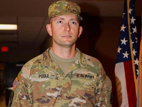 Maj. Jeff Poole stands at attention during his September 2019 promotion ceremony at Fort Benning, Ga. The Army has recommended Poole be discharged after his racist, violent online activity came under investigation. (98th Training Division Facebook)