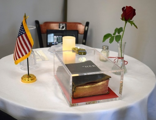 A Bible is part of a memorial table display at the veterans hospital in Manchester, N.H. An Air Force veteran has sued the director of the hospital over the display of the Bible. (Kristin Pressly/Manchester VA Medical Center via AP)
