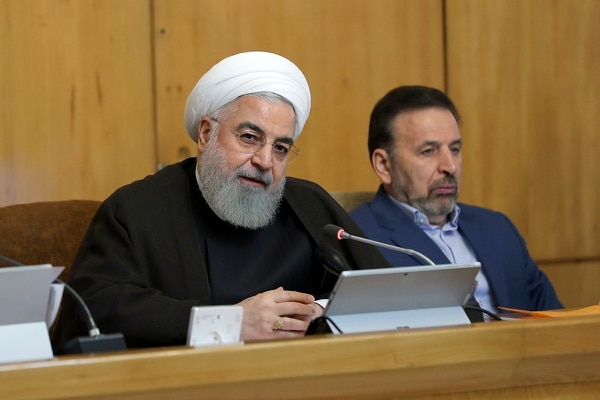In this photo released by the official website of the office of the Iranian Presidency, President Hassan Rouhani speaks during a cabinet meeting, as President's chief of staff Mahmoud Vaezi sits at right, in Tehran, Iran, Wednesday, July 10, 2019. (Iranian Presidency Office via AP)