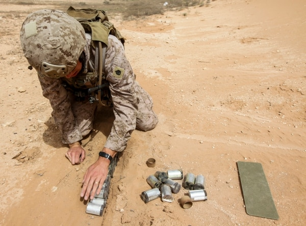 U.S. Marine Staff Sgt. Wright, team lead for the explosive ordnance disposal team attached to Task Force Al Asad, prepares for a controlled detonation of unexploded ordnance at Al Asad Air Base, Iraq, April 21, 2015. (U.S. Marine Corps Photo by Cpl. Cansin P. Hardyegritag)