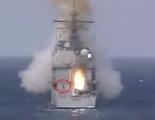 A still image taken from video shows a sailor who narrowly missed a missile being fired from a guided-missile cruiser in 2001. (via YouTube)