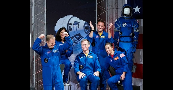 Astronauts, from left, Eric Boe, Sunita Williams, Christopher Ferguson, Josh Cassada and Nicole Mann react after being introduced at a NASA event to announce them as astronauts assigned to crew the first flight tests and missions of the Boeing CST-100 Starliner and SpaceX Crew Dragon, Friday, Aug. 3, 2018, in Houston. (David J. Phillip/AP)