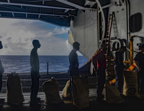 Sailors aboard the aircraft carrier Theodore Roosevelt last year. (Navy)