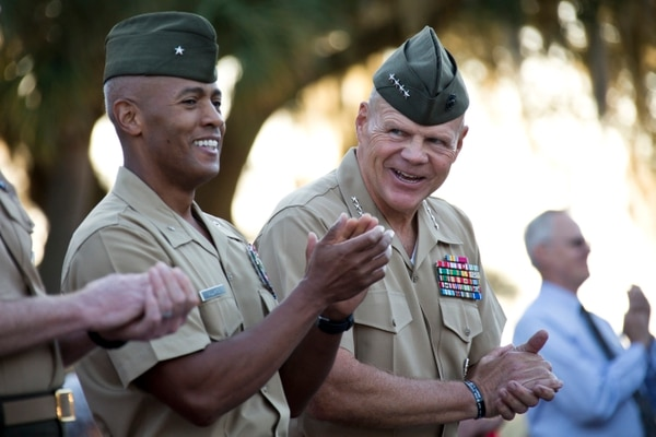 Commandant of the Marine Corps Gen. Robert B. Neller, right, and Brig. Gen. Terry V. Williams, left, the commanding general of Marine Corps Recruit Depot (MCRD) Parris Island (PI), clap during morning colors at MCRD PI, S.C., Oct. 16, 2015. Neller outlined the Corps' current priorities and expectations, and listened to and answered questions during his visit. (U.S. Marine Corps photo by Sgt. Gabriela Garcia/Released)