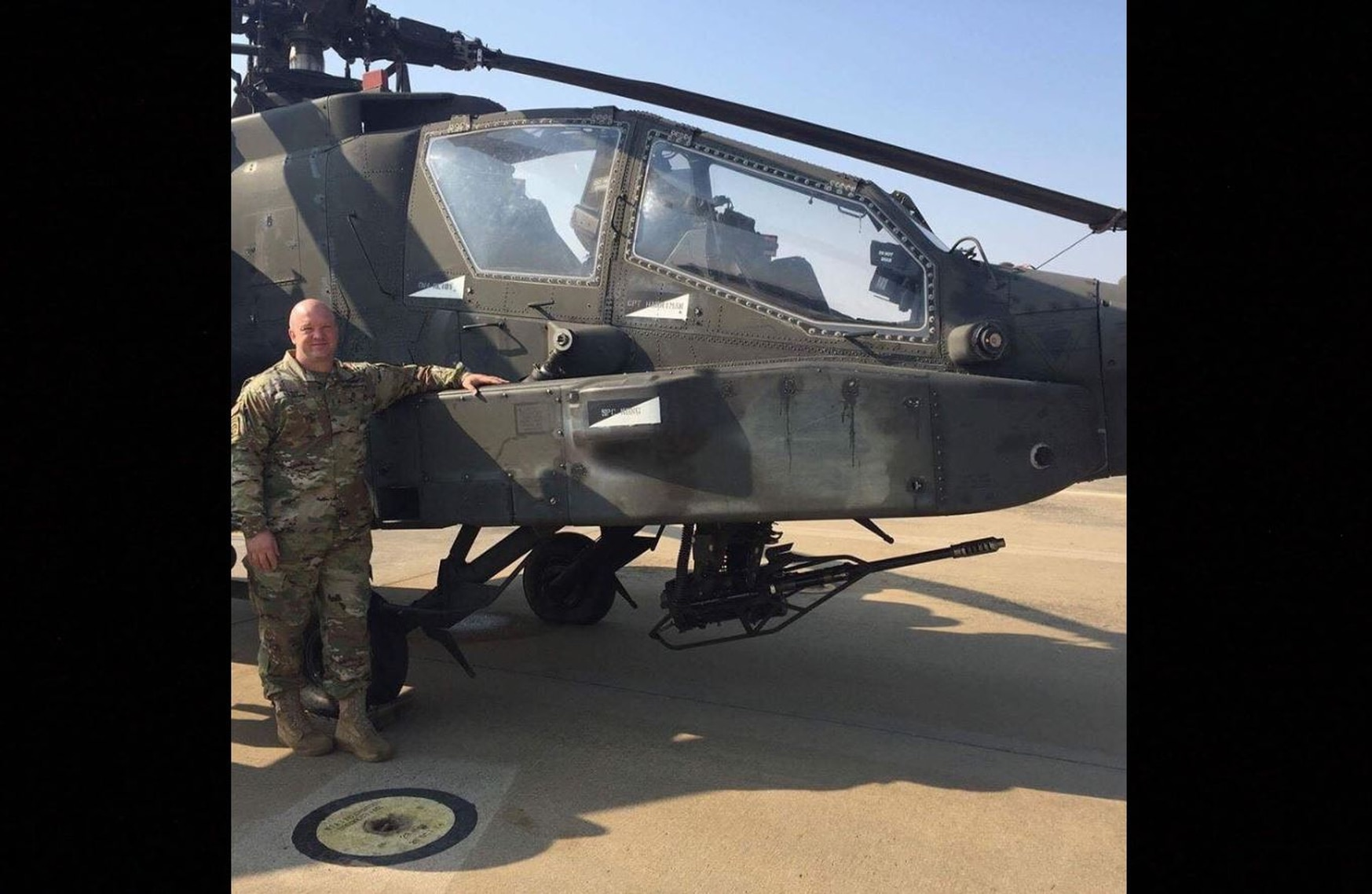 CW4 Paul J. Reidy stands next to his AH-64 Apache, the attack helicopter in which he flew nearly 1,000 hours of combat. (Jennifer Reidy/Courtesy photo)