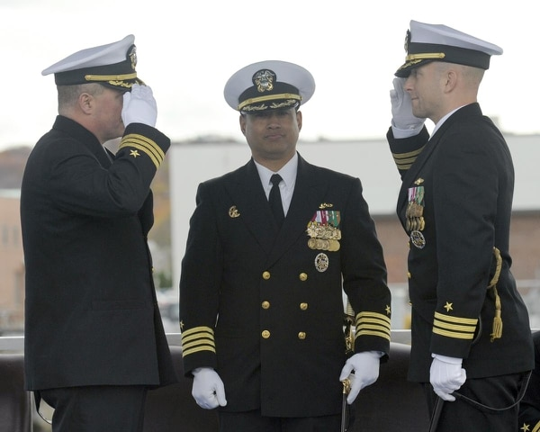 GROTON, Conn. - Cmdr. Jack Houdeshell, left, is relieved by Cmdr. Edward Byers, right, during the USS Dallas (SSN 700) change of command ceremony at Naval Submarine Base New London, Nov. 14, as presiding officer Capt. Butch Dollaga, Commander Submarine Development Squadron 12, center, looks on. The guest speaker was Capt. Christopher Harkins, director for training, tactical development, doctrine and operational safety for Commander Naval Submarine Force Atlantic. Harkins was Commanding Officer on USS Montpelier (SSN 765) while Houdeshell served as Executive Officer.