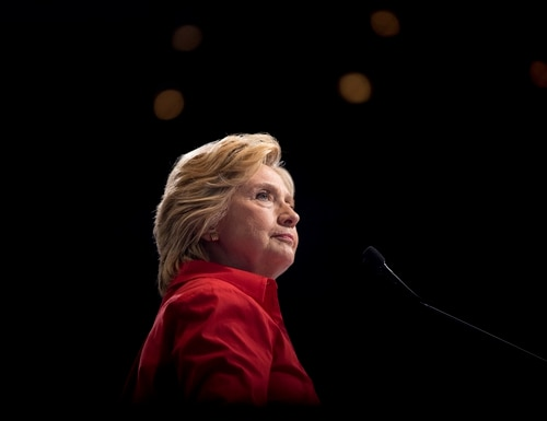 In this Saturday, July 30, 2016 file photo, Democratic presidential candidate Hillary Clinton pauses while speaking at a rally in Pittsburgh during a bus tour through the rust belt. (Andrew Harnik/AP)