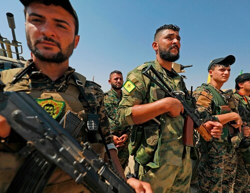 Members of the People's Protection Units (YPG), part of the of the Syrian Democratic Forces (SDF), gather in the town of Shadadi, about 60 kilometers (37 miles) south of the northeastern Syrian city of Hassakeh, on Sept. 11, 2018. (Delil Souleiman/AFP via Getty Images)