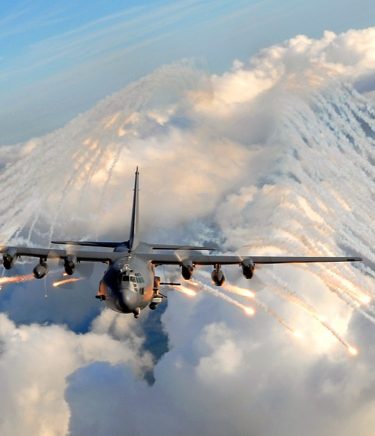 An AC-130U Spooky Gunship from the 4th Special Operations Squadron jettisons flares over an area near Hurlburt Field, Florida, on August 20, 2008. (Air Force)