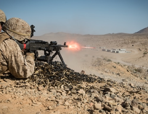 A Marine with Kilo Company, 3rd Battalion, 5th Marine Regiment, provides cover fire for his squad during the Marine Air-Ground Task Force Integrated Experiment (MIX-16) at Marine Corps Air Ground Combat Center Twentynine Palms, Calif., Aug. 5, 2016. The experiment was conducted to test new gear and assess its capabilities for potential future use. The Marine Corps Warfighting Lab (MCWL) identifies possible challenges of the future, develops new warfighting concepts, and tests new ideas to help develop equipment that meets the challenges of the future operating environment. (U.S. Marine Corps photo by Lance Cpl. Julien Rodarte)