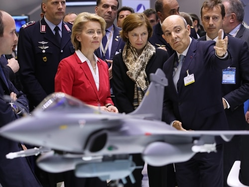German Defence Minister Ursula von der Leyen, left, and French Armed Forces Minister Florence Parly, center, listen as Dassault Aviation CEO Eric Trappier speaks to them at the Dassault Aviation stand at the ILA Berlin Air Show on April 26, 2018, in Schoenefeld, Germany. (Sean Gallup/Getty Images)