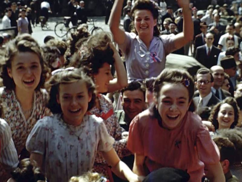 French women cheer U.S. soldiers after the liberation of Paris in 1944
