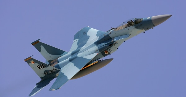 An F-15 with the 65th Aggressor Squadron takes off from Nellis AFB, Nev., in August 2006. The specially camouoflaged F-15s simulate enemy aircraft and tactics. (Courtesy of Paul Ridgway/Typhire Photography)