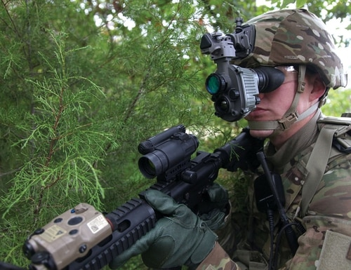 An AN/PSQ-20 Enhanced Night Vision Goggle is photographed being worn by a soldier. (Army)