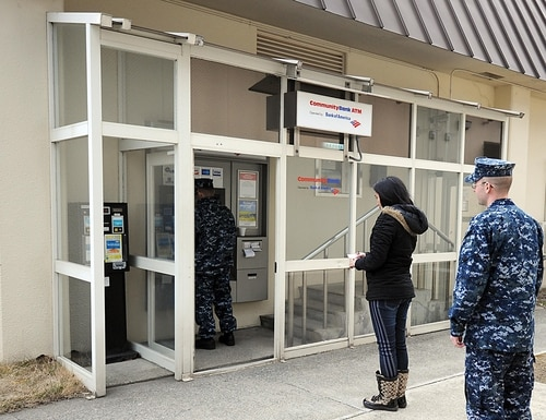 A line forms outside a local automatic teller machine at Misawa Air Base, Japan. (Air Force)