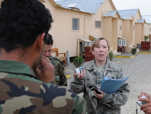 Air Force Maj. Christy Barry, a lawyer and member of the first cohort of U.S. service members and civilians in the AFPAK Hands program, speaks Dari with Afghan national army officers in April 2010 at the Counter Insurgency Training Academy on Camp Julien, Afghanistan. (Sgt. 1st Class Matthew Chlosta/Army)