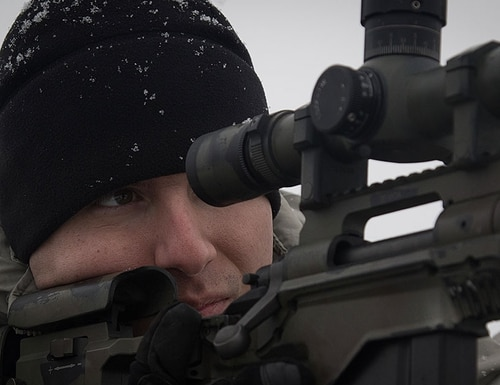 Sgt. Conrado Hoyos, a sniper assigned to Headquarters and Headquarters' Troop sniper section, 3rd Squadron, 2nd Cavalry Regiment, peers through the scope of his M2010 rifle as he acquires his target at a range near the Bemowo Piskie Training Area, Poland. (U.S. Army photo by Spc. Andrew McNeil)