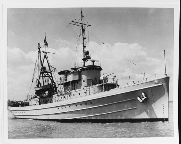 The tugboat Cherokee (AT-66) at anchor. (A gift of the U.S. Naval Institute Photo Collection, now in the collections of U.S. Naval History and Heritage Command)