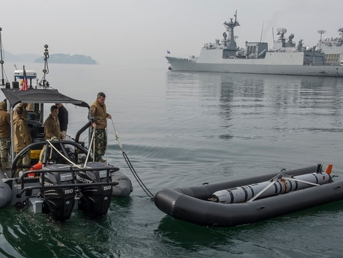Sailors with Explosive Ordnance Disposal Mobile Unit 5 depart a South Korean naval pier at Jinhae-gu on March 31, 2016, to conduct mine countermeasures operations as part of exercise Foal Eagle. President Donald Trump has said he will suspend similar