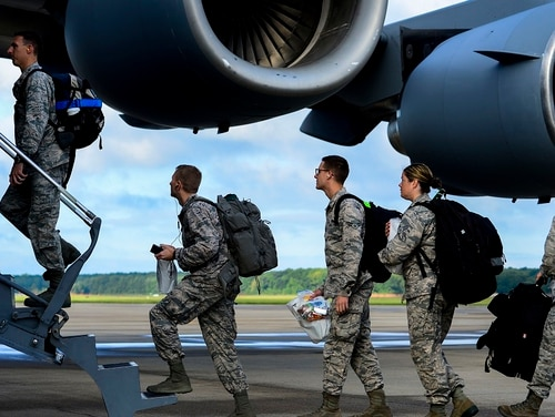 Airmen assigned to the 633rd Medical Group load onto a C-17 Globemaster at Langley Air Force Base, Va., in September 2014. The Air Force says there are about 1,600 active-duty airmen who are at risk of separation because they can't deploy. (Senior Airman Kayla Newman/Air Force)
