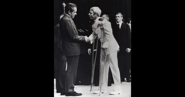 In this May 25, 1973, file photo, U.S. Navy Lt. Cmdr. John McCain is greeted by President Richard Nixon, left, in Washington, after McCain's release from a prisoner of war camp in North Vietnam. (Harvey Georges/AP)