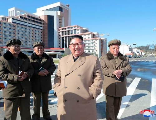 In this undated photo provided on Wednesday, Oct. 16, 2019, by the North Korean government, North Korean leader Kim Jong Un, second right, visits a construction site in Samjiyon County, North Korea. (Korean Central News Agency/Korea News Service via AP)