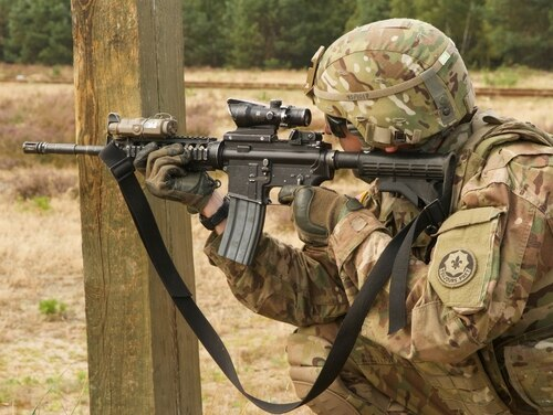 Sgt. Scott Pearson, with 4th Squadron, 2nd Cavalry Regiment, participates in a combined rifle qualification range with Polish soldiers Aug. 18, 2015, in Poland. (Spc. Marcus Floyd/Army)