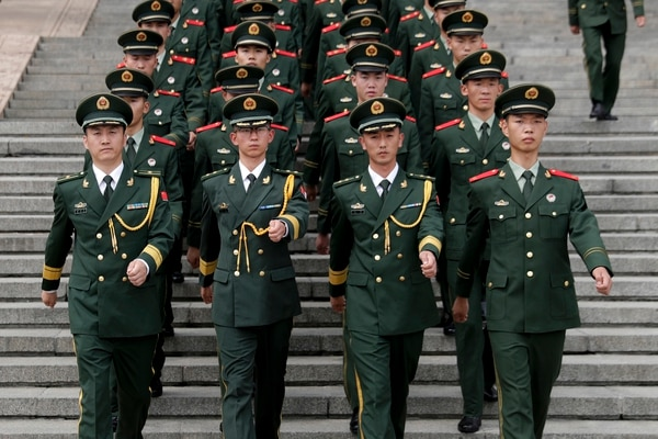Chinese paramilitary policemen march outside the Great Hall of the People after attending a ceremony to commemorate the 90th anniversary of the founding of the People's Liberation Army in Beijing, Tuesday, Aug. 1, 2017. (Andy Wong/Pool, AP)