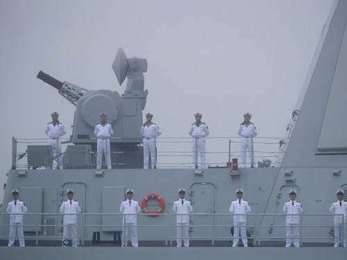 Sailors stand on the deck of the new Type 055 guide-missile destroyer Nanchang of the Chinese People's Liberation Army Navy as it participates in a parade on April 23, 2019. (Mark Schiefelbein/AFP via Getty Images)