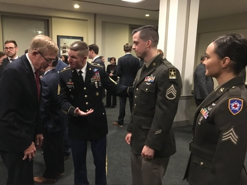 Sergeant Major of the Army Dan Dailey, second from left, shows off a pinks and greens prototype to lawmakers on Capitol Hill. (Courtesy photo)