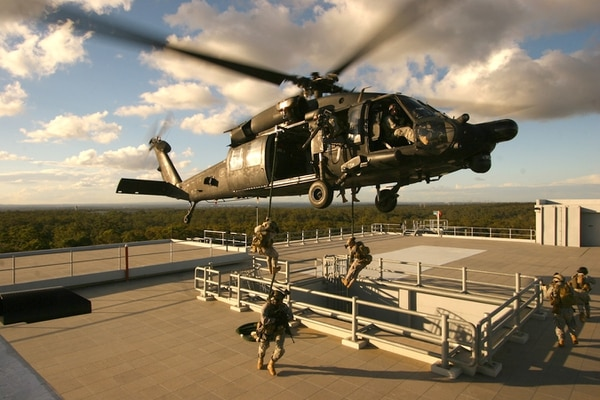 Special operations soldiers fast-rope from an MH-60 to an objective. 160th SOAR pilots are considered some of the best rotary-wing aviators in the U.S. military. (Army)