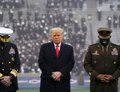 President Donald Trump (center) stands on the field before the 121st Army-Navy Football Game in Michie Stadium at the United States Military Academy in West Point, N.Y., on Dec. 12, 2020. (Andrew Harnik/AP)
