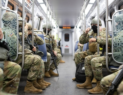 Soldiers with the North Carolina National Guard ride a Metro train that will get them to the station they will guard for the 59th Presidential Inauguration in Washington on Jan. 20, 2021. (Sgt. Abraham Morlu/Army National Guard)