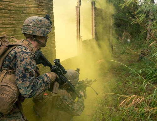 Marines with Alpha Company, Battalion Landing Team, 1st Battalion, 5th Marines, 31st Marine Expeditionary Unit, close with an enemy machine gun position during a simulated raid at the Central Training Area, Okinawa, Japan, on Dec. 11, 2019. (Lance Cpl. Andrew R. Bray/Marine Corps)