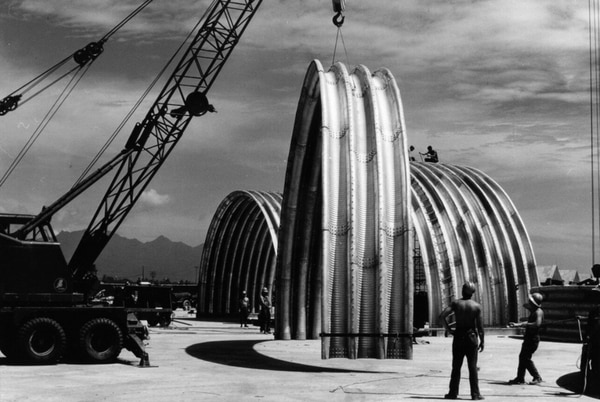 Seabees of U.S. Naval Mobile Construction Battalion 8 move a section of an aircraft shelter into place at the Marine Air Group 11 Area, Da Nang, Republic of Vietnam, in 1969. (National Archives)
