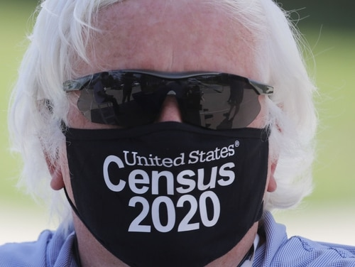 Amid concerns of the spread of COVID-19, census worker Ken Leonard wears a mask as he mans a U.S. Census walk-up counting site set up for Hunt County in Greenville, Texas, Friday, July 31, 2020. (LM Otero/AP)
