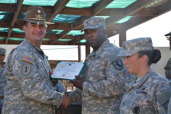 LTC James Stephens CDR, RSS, 11th ACR presents the Army Achievement Medal to SPC Williams for his outstanding performance during the FY15 Platinum Wrench Program