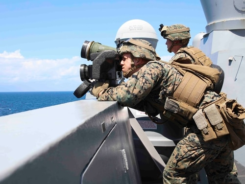 Marine Pfc. Matthew Bell aims an FGM-147 Javelin as part of a simulated small boat attack on amphibious transport dock ship Arlington (LPD 24) during the Carrier Strike Group FOUR (CSG 4) Amphibious Ready Group, Marine Expeditionary Unit exercise. (Mass Communication Specialist 2nd Class Brandon Parker/Navy)