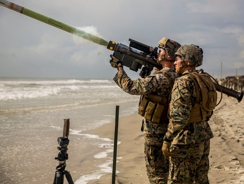 U.S. Marine Corps Sgt. Christopher P. Roseblossom, left, a low altitude air defense (LAAD) gunner with the 2nd LAAD Battalion, fires an FIM- 92 Stinger missile. (Lance Cpl. Cody J. Ohira/Marine Corps)