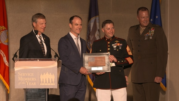 Master Sgt. Jarad Stout, Marine Corps Times Marine of the Year accepting his award from Rep. Brian Babin, R-Texas, Maj. Gen. Mark Wise, the deputy commanding general for Marine Corps Combat Development Command, and Andrew Tilghman, the executive editor of Military Times.