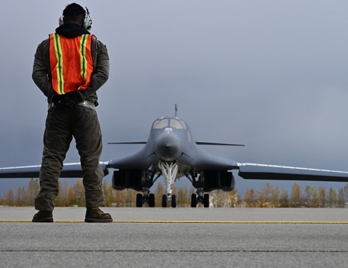 U.S. Air Force Technical Sgt. Rory Riggs marshals a B-1 Lancer at Eielson Air Force Base, Alaska, Sept. 10, 2020. (Senior Master Sgt. Ted Daigle/Air Force)