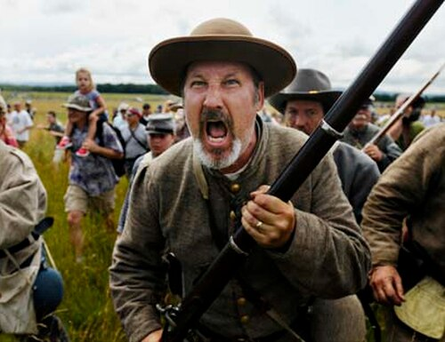John Fredal, of Detroit, Mi., joins other reenactors and visitors march across the site of Pickett's Charge during the 150th Anniversary of the Battle of Gettysburg in Gettysburg, Pa., on Wednesday, July 3, 2013. (Mike Morones/Staff)