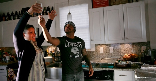 In this Nov. 24, 2016, photo, Taryn McLean and his friend, Noelia Ramirez, offer a toast before the start of their Thanksgiving meal in Portsmouth, Va. Taryn was born female but identifies as male. He is among 11,000 transgender active duty and reserve troops that the RAND Corp. estimated, in a report prepared for the Pentagon, are serving in the armed forces. (Kristen Zeis/The Virginian-Pilot via AP)