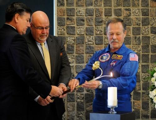 Marshall Space Flight Center Director Patrick Scheurmann, left, Space Launch System Program Office Deputy Director John Honeycutt, center, and five-time shuttle astronaut Robert