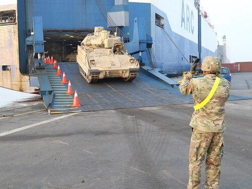 A Bradley Fighting Vehicle belonging to 1st Armored Brigade Combat Team, 1st Cavalry Division offloads it to the port of Antwerp. In the event of a crisis, moving large numbers of troops and equipment could be a major challenge to the U.S. (U.S. Army photo)
