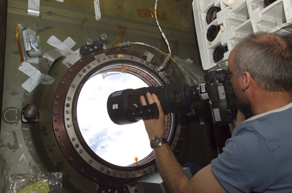 Astronaut, Army Col. Jeffrey N. Williams, Expedition 13 NASA space station science officer and flight engineer, uses a camera to photograph the topography of a point on Earth from the nadir window in the Destiny laboratory of the International Space Station.