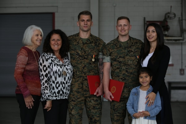 Navy and Marine Corps Medal recipients Sgt. Austin Cox, right, and Sgt. Michael Vura, left, pose with family members of the victims of the Route 91 Harvest Music Festival shooting following an awards ceremony at Marine Corps Air Station Camp Pendleton, California, April 29. (Lance Cpl. Julian Elliott-Drouin/Marine Corps)